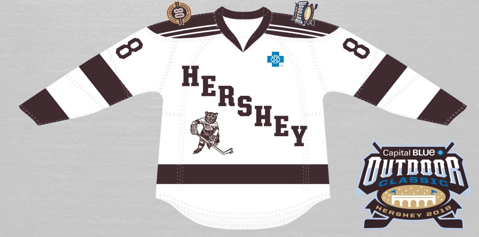 """a15552d9 The white and brown jersey features a fierce hockey-playing bear, a nod to  the original Bears logo, and """"Hershey"""" spelled out diagonally across the  jersey's ..."""